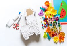 Diy cinco de mayo Mexican Pinata llama made cardboard and crepe paper your own hands on a white background. Gift idea, decor, game cinco de mayo. Step by step stock photo