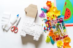 Diy cinco de mayo Mexican Pinata llama made cardboard and crepe paper your own hands on a white background. Gift idea, decor, game cinco de mayo. Step by step royalty free stock image