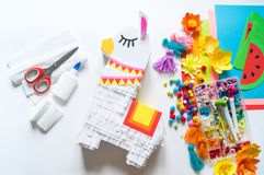Diy cinco de mayo Mexican Pinata llama made cardboard and crepe paper your own hands on a white background. Gift idea, decor, game cinco de mayo. Step by step royalty free stock photography