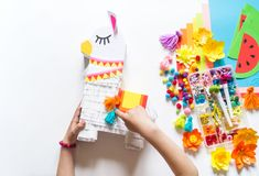 Diy cinco de mayo Mexican Pinata llama made cardboard and crepe paper your own hands on a white background. Gift idea, decor, game cinco de mayo. Step by step stock image