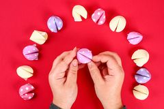 Diy cookie with predictions on a red background. Gift ideas, decor for Chinese new year. Handmade. Fortune cookies from a multi-. Diy cookie with predictions on stock images