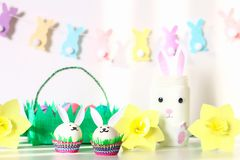 Diy decor for Easter. Paper garlands, vase bunny, daffodils, eggs bunnies, basket with painted eggs royalty free stock images