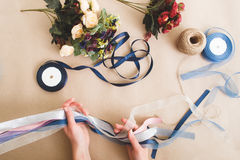 Diy decoration from artificial flowers and ribbons Royalty Free Stock Photo