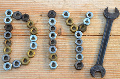 DIY (do it yourself) text from small nuts and spanner Royalty Free Stock Images