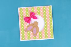 Diy Easter cards from paper. Volume greeting cards with a bunny, egg on blue background. 3d. Gift idea, decor Spring, Easter. Step by step. Top view. Process royalty free stock photography