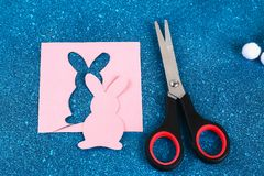 Diy Easter garland bunnies, flags EASTER made paper blue background. Gift idea, decor Spring, Easter. Diy Easter garland bunnies, flags with letters EASTER made stock photography