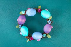 Diy Easter wreath of twigs, painted eggs and artificial flowers on a green background. Gift idea, decor Spring, Easter. Step by step. Top view. Process kid stock image