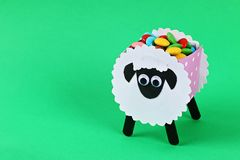 Diy Eid al adha lamb sheep cotton pads, cotton buds, swabs Gift idea, decor Eid al adha. Diy Eid al adha lamb sheep cotton pads, cotton buds, swabs on green stock photography