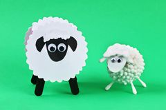 Diy Eid al adha lamb sheep cotton pads, cotton buds, swabs Gift idea, decor Eid al adha. Diy Eid al adha lamb sheep cotton pads, cotton buds, swabs on green stock photo