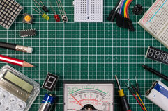 DIY electrical maker tools components on green cutting mat board. stock image