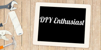 Diy enthusiast against tools and tablet on wooden background Stock Image