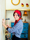 Diy fashion woman with nail and hammer. On grunge house Stock Images