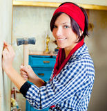 Diy fashion woman with nail and hammer Royalty Free Stock Photography
