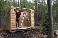 Handyman building a Cedar Storage Shed Royalty Free Stock Photo
