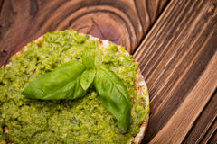 Diy homemade radish leaves pesto. Natural homemade DIY vegan very healthy green pesto made of radish leaves and nutritional yeast flakes on a rice waffle with Royalty Free Stock Photography