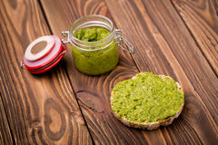 Diy homemade radish leaves pesto. Natural homemade DIY vegan very healthy green pesto made of radish leaves and nutritional yeast flakes on a rice waffle in a Stock Photos