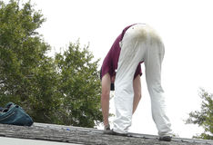 DIY Homeowner Repairing Roof Leak Stock Photo