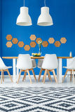 Dining room with patterned rug Stock Photos