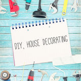 Diy, house decorating against tools and notepad on wooden background Stock Photography