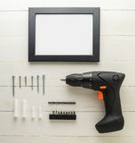 DIY-Inneneinrichtung stellte mit Schraubenzieherhammer für Installation des Bilderrahmens DIY ein Lizenzfreie Stockbilder