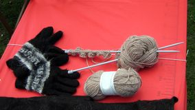 DIY knitting wool yarn, balls, knitting needles, and gloves. Royalty Free Stock Images