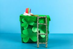 DIY leprechaun trap with gold coins, rainbow and green ladder St Patricks Day background. Gift Idea, decor Saint Patricks Day. Step by step. Child kid craft stock photography