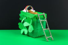 DIY leprechaun trap with gold coins, rainbow and green ladder St Patricks Day background. Gift Idea, decor Saint Patricks Day. Step by step. Child kid craft royalty free stock photos
