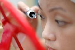 DIY make-up. Asian woman doing make-up Royalty Free Stock Photos
