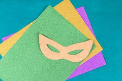 Diy Masquerade mask Mardi Gras, Fat Tuesday. Gift idea, decor Mardi Gras. Carnival mask cardboard, sequins, paper, beads. Step by step. process childrens royalty free stock photos