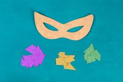 Diy Masquerade mask Mardi Gras, Fat Tuesday. Gift idea, decor Mardi Gras. Carnival mask cardboard, sequins, paper, beads. Step by step. process childrens royalty free stock images