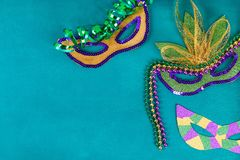 Diy Masquerade mask Mardi Gras, Fat Tuesday. Gift idea, decor Mardi Gras. Carnival mask cardboard, sequins, paper, beads. Step by step. process childrens stock image
