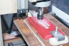 DIY Mini CNC Machine for 3D carving. Process of 3D cutting, machining and sculpting. royalty free stock photography