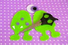 Sewing set for felt monster - how to make a monster handmade toy. DIY monster stuffed. Cute felt monsters. Monster pattern. Fabric monster pattern. Felt monster stock photo