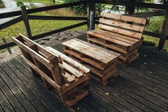 DIY pallet furniture. DIY pallet outdoors furniture in house backyard, selective focus Stock Photos
