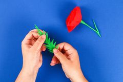 Diy paper red poppy Anzac Day, Remembrance, Remember, Memorial day crepe paper on blue background. 32 Diy paper red poppy Anzac Day, Remembrance, Remember royalty free stock photos