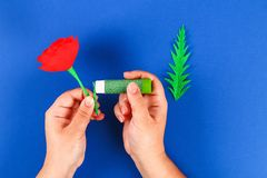 Diy paper red poppy Anzac Day, Remembrance, Remember, Memorial day crepe paper on blue background. 33 Diy paper red poppy Anzac Day, Remembrance, Remember stock photography