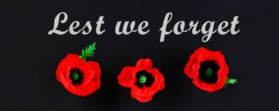 Diy paper red poppy Anzac Day, Remembrance, Remember, Memorial day crepe paper on black background. Diy paper red poppy Anzac Day, Remembrance, Remember stock image