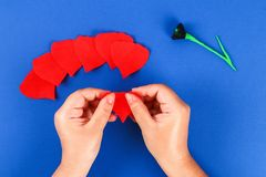 Diy paper red poppy Anzac Day, Remembrance, Remember, Memorial day crepe paper on blue background. 21 Diy paper red poppy Anzac Day, Remembrance, Remember royalty free stock photos