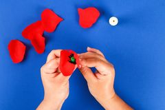 Diy paper red poppy Anzac Day, Remembrance, Remember, Memorial day crepe paper on blue background. 24 Diy paper red poppy Anzac Day, Remembrance, Remember royalty free stock photography