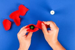 Diy paper red poppy Anzac Day, Remembrance, Remember, Memorial day crepe paper on blue background. 25 Diy paper red poppy Anzac Day, Remembrance, Remember royalty free stock photo