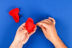 Diy paper red poppy Anzac Day, Remembrance, Remember, Memorial day crepe paper on blue background. 26 Diy paper red poppy Anzac Day, Remembrance, Remember stock images