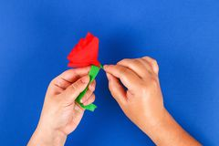 Diy paper red poppy Anzac Day, Remembrance, Remember, Memorial day crepe paper on blue background. 29 Diy paper red poppy Anzac Day, Remembrance, Remember stock photo