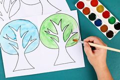 Diy paper tree four seasons summer, autumn, winter, spring. Tree 4 season. Childrens creativity. 2 Diy paper tree four seasons summer, autumn, winter, spring royalty free stock photography