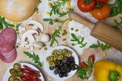 DIY pizza do it yourself - pizza dough royalty free stock photos