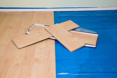 DIY project: installing maple finished laminate floor in living. Room and hallway Royalty Free Stock Photo