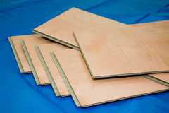 DIY project: laminate floor planks (unused and cut) Royalty Free Stock Photography