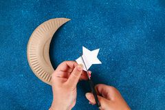 Free Diy Ramadan Kareem Crescent Moon With A Star From A Disposable Cardboard Plate And Gold Paint Stock Photography - 146036622