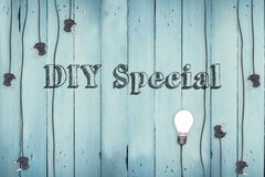 Diy special against plugs on wooden background Royalty Free Stock Images