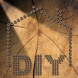 Diy Symbol - Screws on Wooden Background Royalty Free Stock Images