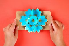 Diy three-dimensional 3d greeting card with flowers for mothers day on a Living coral background. 37 Diy three-dimensional 3d greeting card with flowers for stock photography